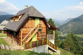 Old wooden house on mountain landscape — Stock Photo