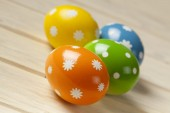 Easter eggs on wooden boards — Stock Photo