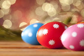 Colored Easter eggs on wooden planks — Stock Photo