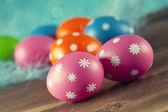 Colored Easter eggs on blue background — ストック写真