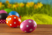 Colored Easter eggs on blue background — Stock Photo
