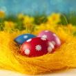 Colored Easter eggs on blue background — Stock Photo #68857357