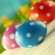 Colored Easter eggs on blue background — Stock Photo #68857421