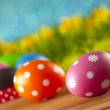 Colored Easter eggs on blue background — Stock Photo #68857805