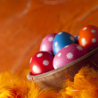Colored Easter eggs on orange background — Stock Photo #68858115