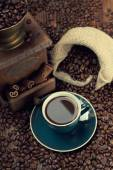 Cup of coffee, coffee beans and old grinder — Stock Photo