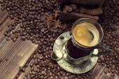 Coffee cup and beans, old coffee grinder  — Stock Photo