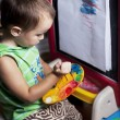 A boy is painting by brush on the easel — Stock Photo #59906681