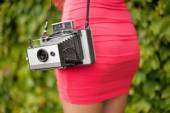 Girl with old camera — Stock Photo