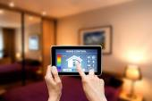 Remote home control system on a digital tablet. — Stock Photo
