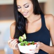 Young woman eating a healthy fresh salad — Stock Photo #52143333