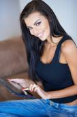 Gorgeous young woman surfing on a tablet-pc — Stock Photo