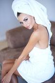 Woman Wearing Bath Towel Looking Over Her Shoulder — Stockfoto
