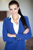 Confident friendly businesswoman — Stock Photo