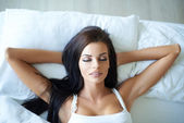 Attractive young woman having a lie in — Stock Photo