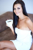 Beautiful woman relaxing with her morning coffee — Stock Photo