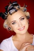 Beautiful blond with her hair in curlers — Stock Photo