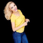 Smiling beautiful blond woman wearing makeup — Stock Photo