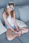 Cute pretty woman listening to her music — Stock Photo