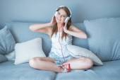 Happy relaxed young woman listening to music — Foto de Stock