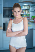 Shapely attractive young woman in sleepwear — Stock Photo