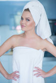 Young Woman Wearing Bath Towel with Hands on Hips — Stockfoto
