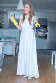 Woman Wearing Wedding Gown Showing Clean Pan — Stock Photo