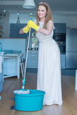 Woman Wearing Wedding Gown with Mop and Bucket — Stock Photo