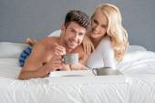 Sweet Young Caucasian Lovers on Bed Having Coffee — Foto de Stock