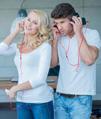 Young Couples on White Blue Attire Listening Music — Stock Photo