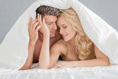 Sweet Young Couple on Bed Fashion Shoot — Foto de Stock