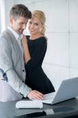 Lovers in Trendy Attire Testing Displayed Laptop — Stock Photo