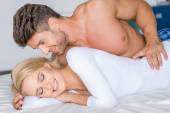 Sweet Sexy Caucasian Couple Lying on White Bed — Stockfoto