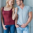 Young Couple on Casual Attire over Light Gray Wall — Stock Photo #54751171