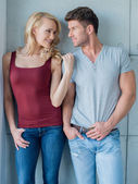 Young Couple on Casual Attire over Light Gray Wall — Stock Photo
