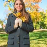 Fashionable young woman enjoying an autumn walk — Stock Photo #54924925