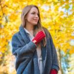Woman enjoying the colorful yellow fall foliage — Stock Photo #54927075
