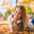 Cute young woman with a lovely warm smile — Stock Photo #54927749