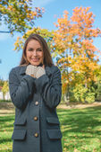 Smiling Pretty Woman Chilling in Gray Coat — Stock Photo
