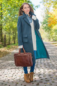 Young Woman in Autumn Season Attire at Pathway — Stok fotoğraf