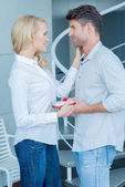 Loving wife giving her husband a Valentines gift — Stockfoto