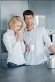Handsome man and his wife enjoying coffee — Stock Photo