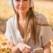 Attractive woman listening to her music library — Zdjęcie stockowe #55161557