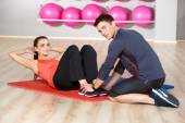 Woman working out with a physical trainer — Stock Photo
