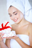 Young woman opening a heart-shaped gift box — Foto de Stock