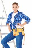 Pretty Young Carpenter Woman on Steel Ladder — Stock Photo