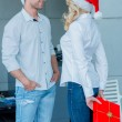 Young couple celebrating Christmas — Stock Photo #55399359
