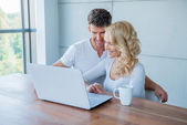 Couple smiling as they check their social media — Stock Photo
