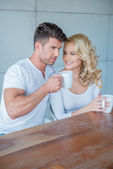 Young couple drinking their morning coffee — Stock Photo