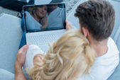 Overhead view of a couple using laptop — Stock Photo